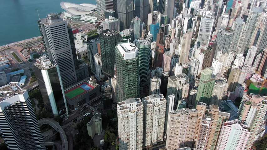Hong Kong upscale Wan Chai district and Victoria Harbour skyscrapers, Aerial view. | Shutterstock HD Video #1055862008