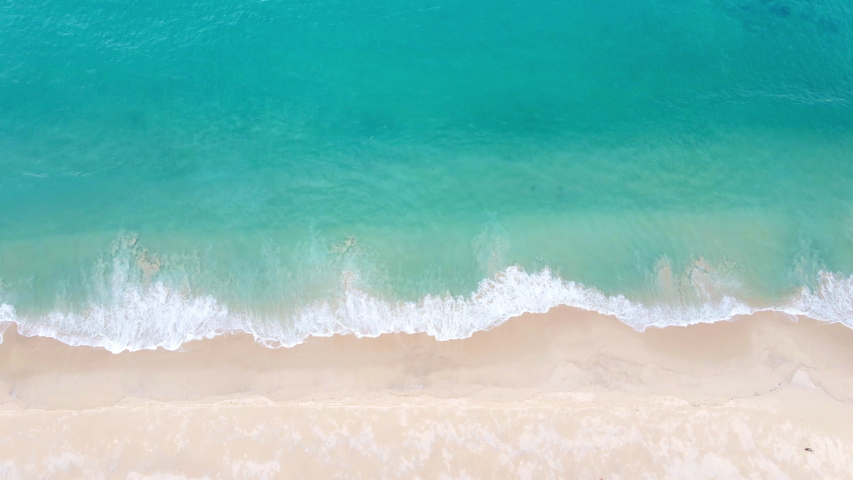 4K Aerial view top view drone move Beautiful topical beach with white sand. Top view empty and clean beach. Beautiful Phuket beach is famous tourist destination at Andaman sea. | Shutterstock HD Video #1055907224