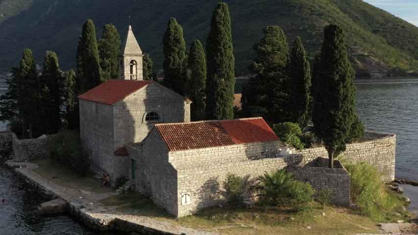 St. George and Gospa od Skrpela islands near town Perast in Montenegro. Sunset. Drone footage.