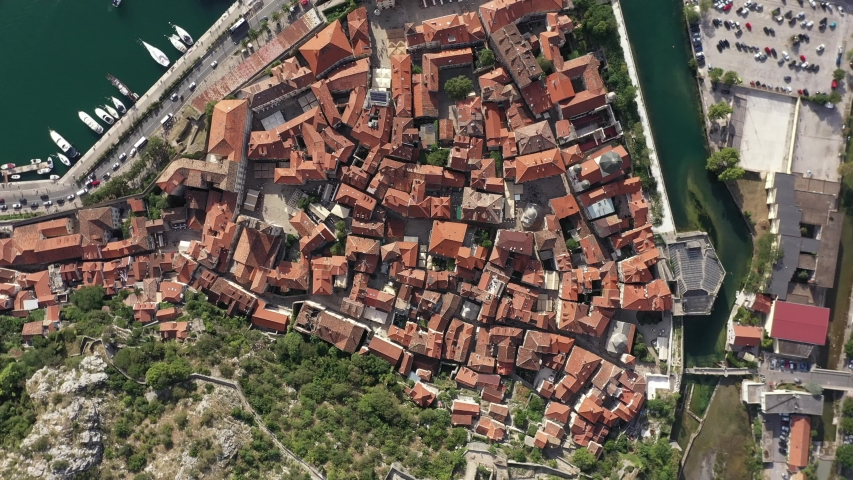 Old town Kotor, Montenegro on the coast of Kotor Bay of Adriatic sea. Old castles, ancient city walls. Drone footage.