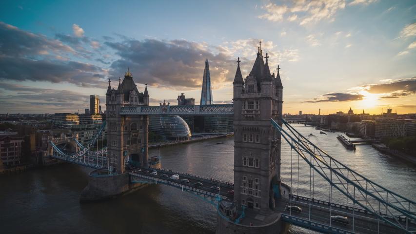 Iconic Tower Bridge, Sunset, Aerial View Shot of London UK, United Kingdom, sun beautifully slides across bridge