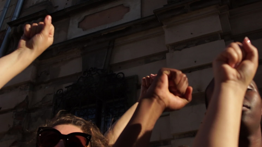 Hands of Diverse Interracial People Holding Up on Background city wall. Black Male and Female Hands . Black Lives Matter. Antiracism. Equality. Royalty-Free Stock Footage #1055927000