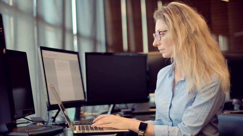 Woman Software Developer.Focused Coder Development Web Application.Senior Programming On Laptop.Girl Software Developer Coding On Computer PC And Remote Chatting.Programmer Design Internet Online App. Royalty-Free Stock Footage #1055933312