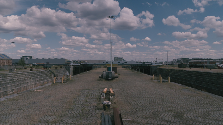 Symmetrical shot revealing two empty drydocks in an abandoned shipyard. Inspire2 X7 12mm prores