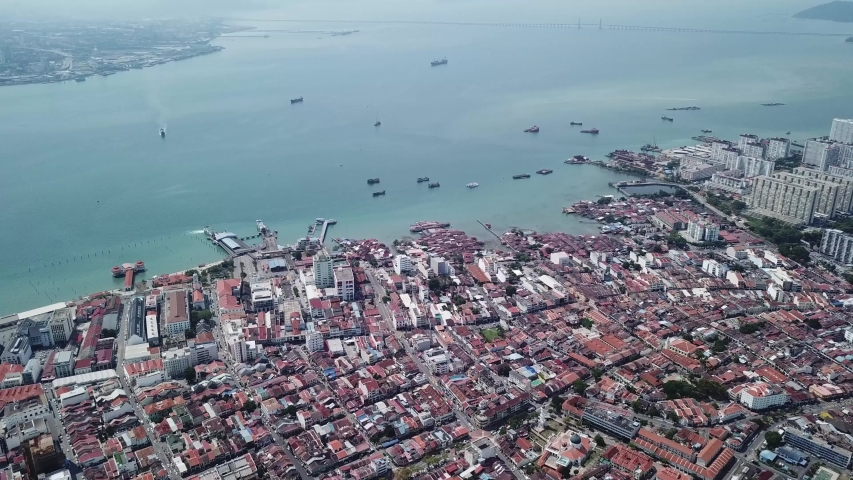 Aerial view old heritage house at Georgetown. Background is Penang Bridge and ferry.