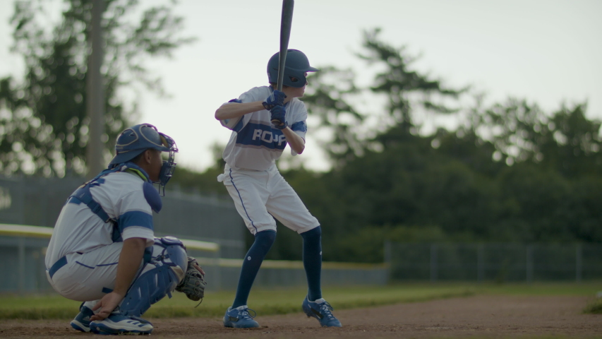 Striking out! Baseball player swing and misses a fastball pitch. Keep swinging. Shot in slow-motion and in 4k.