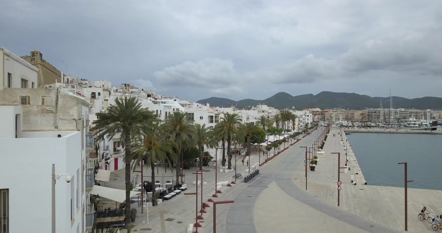 Aerail footage of Ibiza, Spain down town promenade without people