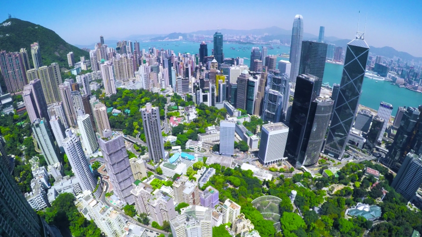 China Hong Kong Aerial with Beautiful Clear Sky. 4K Aerial view of the famous Hong Kong Island. Forward shot flying over office buildings and skyscrapers.
