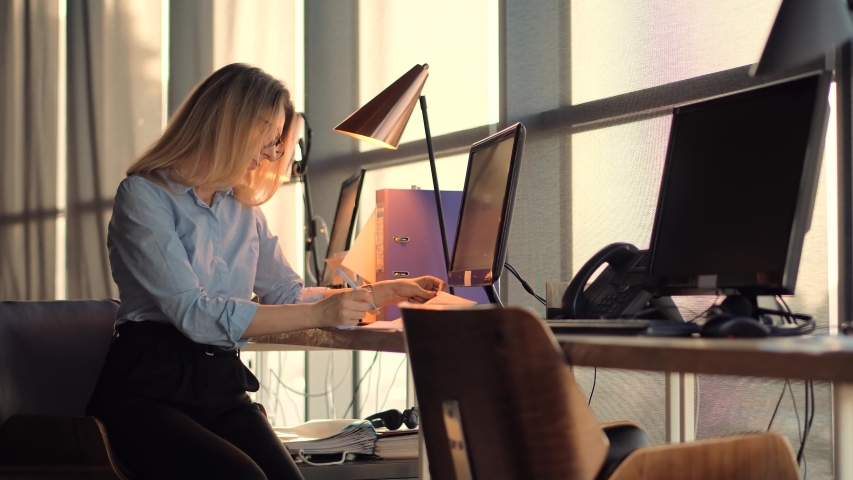 Businesswoman Booker Overworked Working On Project At Deadline.Accountant Overtime Work.Businesswoman Working On Financial Statement.Accountant Calculate Profit.Bookkeeper Auditing In Office Workplace Royalty-Free Stock Footage #1055980715