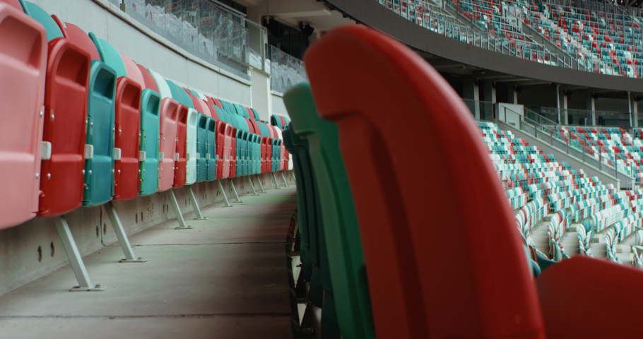WIDE View of empty stadium seats before game or during Coronavirus COVID-19 pandemic. Shot on RED cinema camera Royalty-Free Stock Footage #1055995220