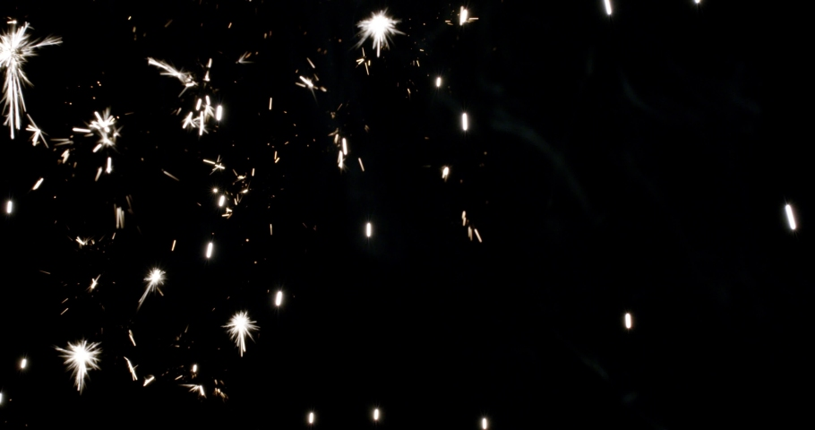 4K Sparks hits on Black Background, Sparks Over Black (ULTRA HD, UHD, 4K). Spark Wall created by Gun Powder Sparks Falling. Slow Motion. (ADD MODE)