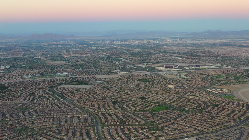 A colorful twilight settles over the city and surrounding communities of Las Vegas, Nevada. This area is growing in population and housing continues to expand.