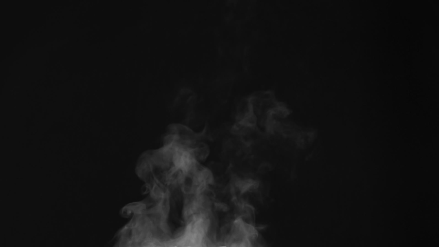 Hot Vapor Stream Tends Up. White Steam rises from a large pot that is behind the scenes. Black background. Filmed at a speed of 240fps   Shutterstock HD Video #1056006368