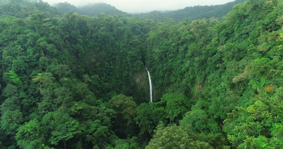 La Fortuna Waterfall in the rainforest near Arenal Volcano in Costa Rica, Central America. Beautiful nature landscape at toursit travel destination landmark.