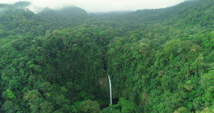 Costa Rica La Fortuna Waterfall in amazing rainforest nature landscape. Aerial drone video.