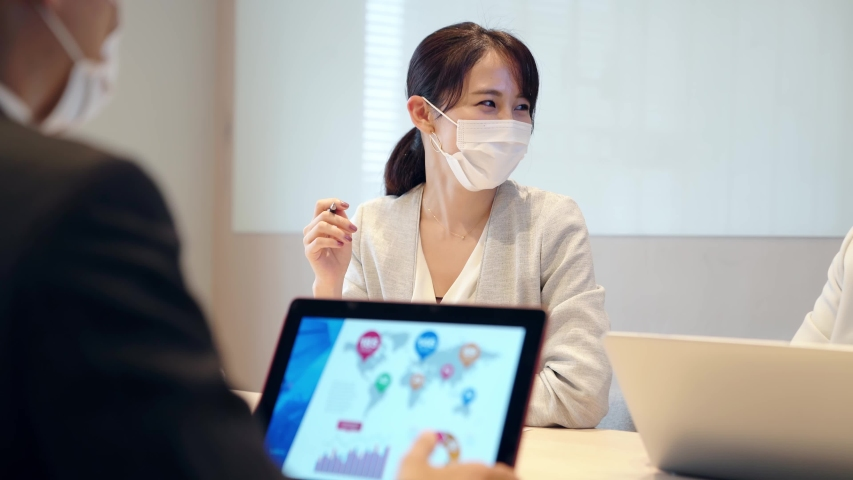 Group of businessperson meeting in the office with surgical mask. Royalty-Free Stock Footage #1056025301