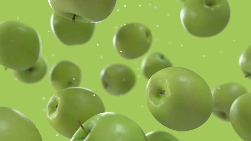 Green Apples Falling Down with Water Drops in Super Slow Motion on Solid Green Background. Endless Seamless Loop 3D Animation