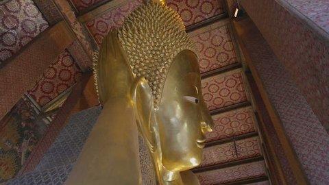 BANGKOK,THAILAND - CIRCA June 2015 :high to low tilt - reclining Buddha side angle