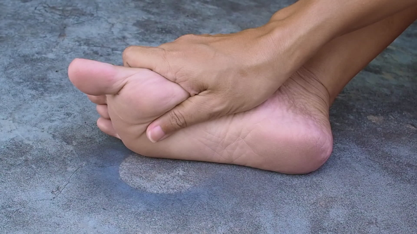 Female feet and soles of the heel with heel pain in adult and Treatment of Plantar Fasciitis. foot inflammatory ligament disease.
