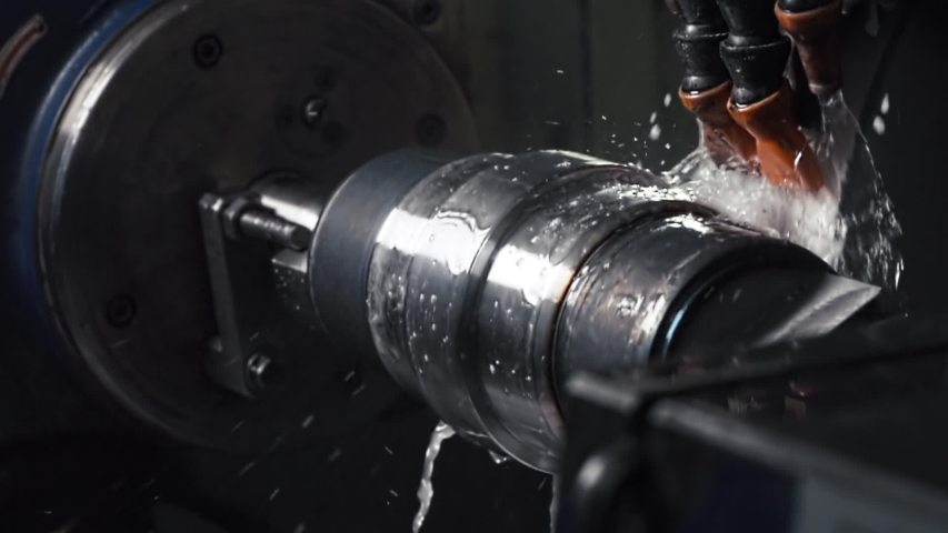Turning Mill Machine at the Modern Factory, Automated CNC System Spins and Works With Water, Fluids, Splashes, Slow Motion, Close Up Royalty-Free Stock Footage #1056044168