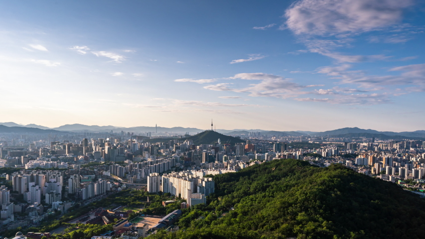 Time lapse 4K Seoul city skyline and Seoul tower modern building and architecture, Beautiful clouds flow through in Seoul, South Korea.