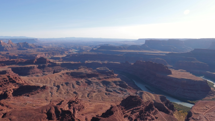 Panorama of picturesque famous grand canyon of Colorado river with red sandstone rocks in light of sunset. Deadhorse national park, popular tourist destination. View from height of observation point