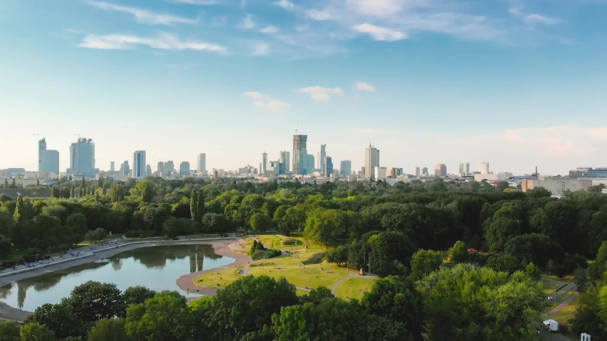 Pole Mokotowskie Warsaw Park field with lake and city aerial view Royalty-Free Stock Footage #1056062993