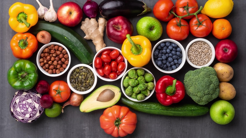 Healthy eating ingredients: fresh vegetables, fruits and superfood. Nutrition, diet, vegan food concept. Royalty-Free Stock Footage #1056070691