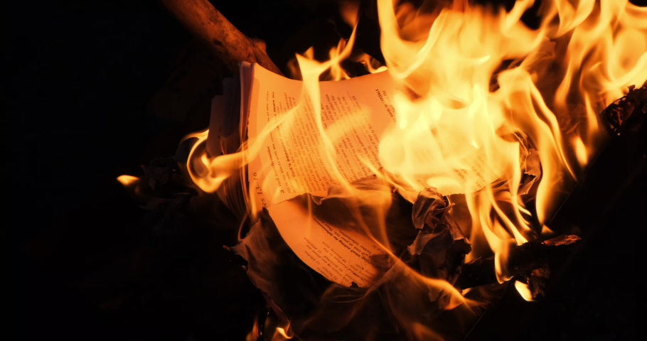 Education book on fire. Big bright flame, burning paper on old historic cultural publication. Destruction English diary journal with Latin characters. Bonfire conflagration in slow motion in the dark | Shutterstock HD Video #1056080465