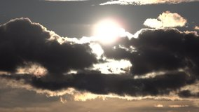 clouds float on it and cover the sun on the sky. Sunset or sunrise. accelerated video Hyperlapse