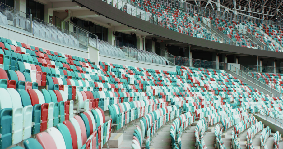WIDE View of empty stadium seats before game or during Coronavirus COVID-19 pandemic. Shot on RED cinema camera Royalty-Free Stock Footage #1056090983
