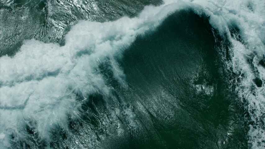 Vitality of blue energy and clear ocean water. Powerful stormy sea waves in top-down drone shot perspective.  Crashing wave line in Open Atlantic sea with foamy white texture. | Shutterstock HD Video #1056098015
