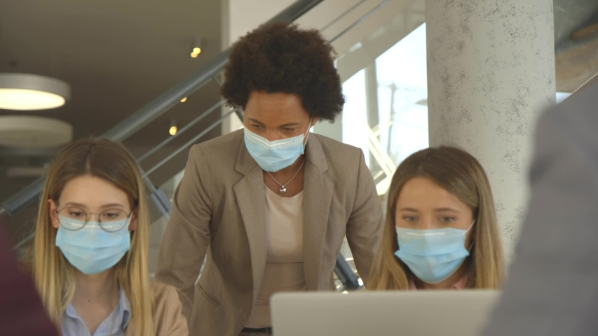 Group business people have a meeting and working in the office and wear masks as protection from corona virus Royalty-Free Stock Footage #1056099476