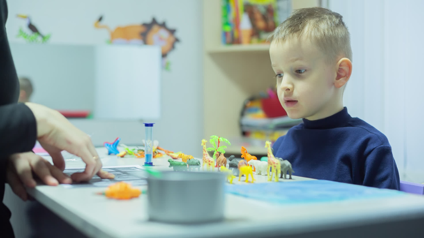 Little Boy with autism syndrome Learning homework And Playing games at Home on quarantine Royalty-Free Stock Footage #1056114653