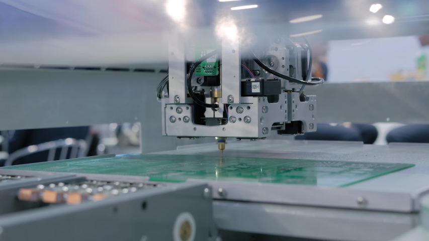 Automated technology, industrial, robotic, electronic, production, manufacturing concept. Assembly of computer circuit board: automatic SMD pick and place machine during work at trade show, exhibition Royalty-Free Stock Footage #1056125594