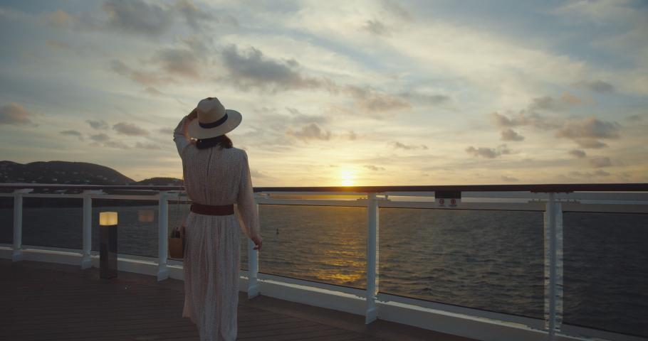 Happy woman at sunset. Shot on Black Magic Cinema Camera | Shutterstock HD Video #1056126248
