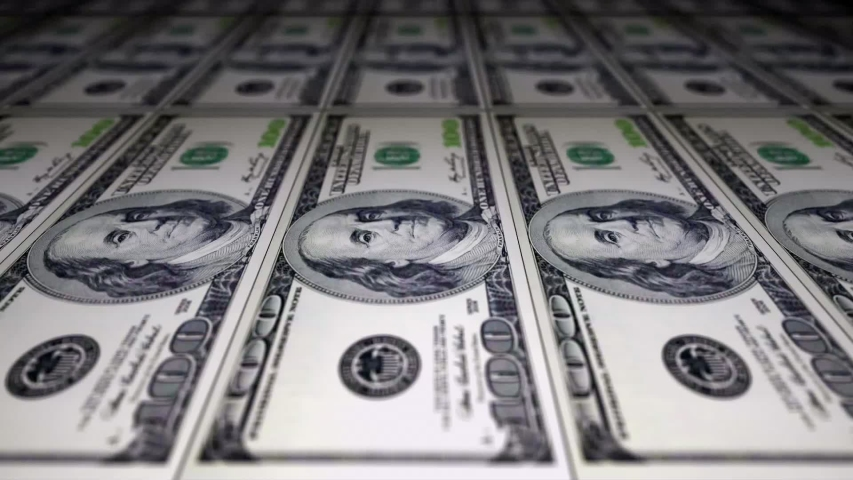 100 Dollar bills print. Inflation and deflation concept. Money making machine. Loop of banknotes being made. Machine printing Benjamin Franklin banknotes.