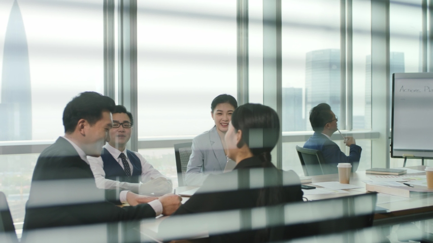 Group of asian businesspeople discussing business plan in modern office | Shutterstock HD Video #1056146465