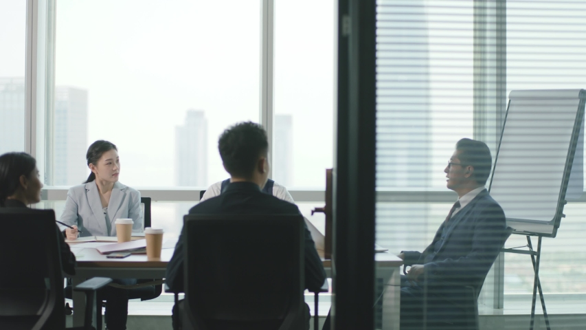 Group of asian business people meeting in modern office conference room | Shutterstock HD Video #1056147308