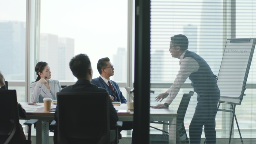 Team of asian business people meeting in modern office conference room | Shutterstock HD Video #1056147311
