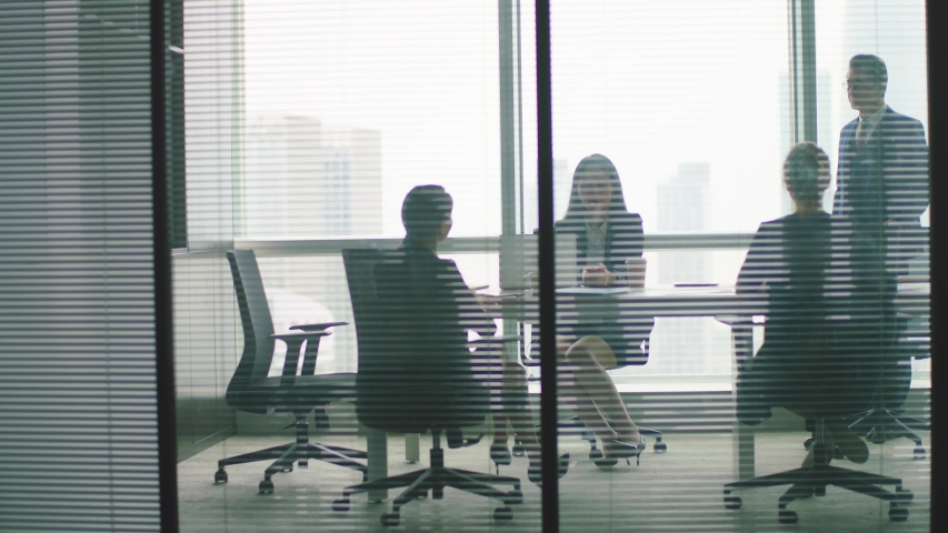 through the glass panoramic shot of business people working in modern corporate office Royalty-Free Stock Footage #1056148958