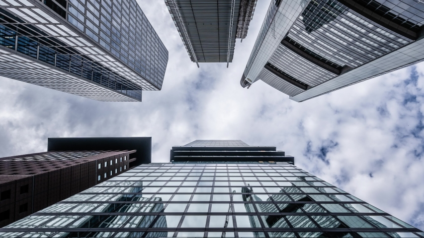 Plane flies above the skyscraper buildings in city Angle view   Shutterstock HD Video #1056149372