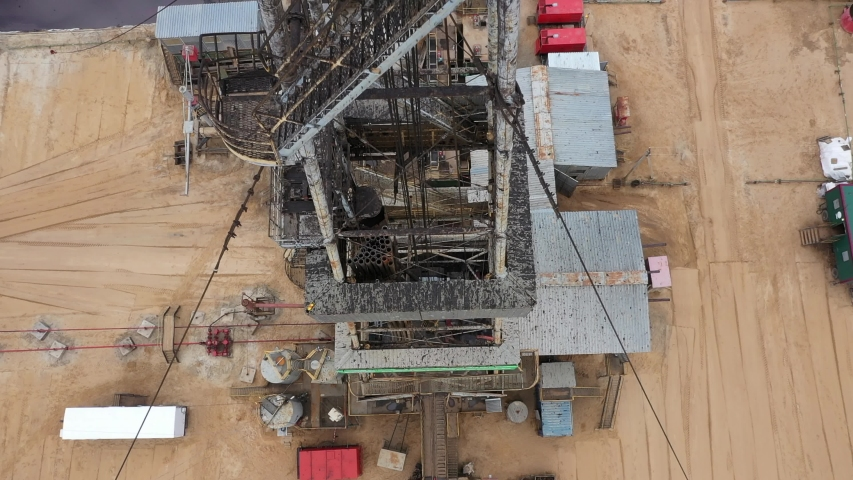 Aerial view. View upwards to work-over and drilling rig. Oil derrick. View from the drilling floor. Oil and gas a land rig, onshore drilling rig Royalty-Free Stock Footage #1056158051