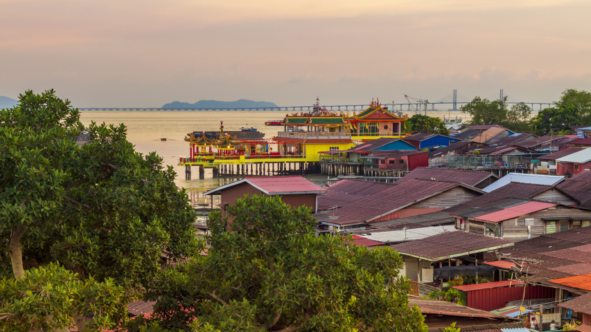 Footage 4k Time-lapse of Aerial view cityscape in harbor Near Hean Boo Thean Kuan Yin Temple, Traditional Chinese place of worship over the water, Day to Night, in Clan jetties Georgetown, Penang.