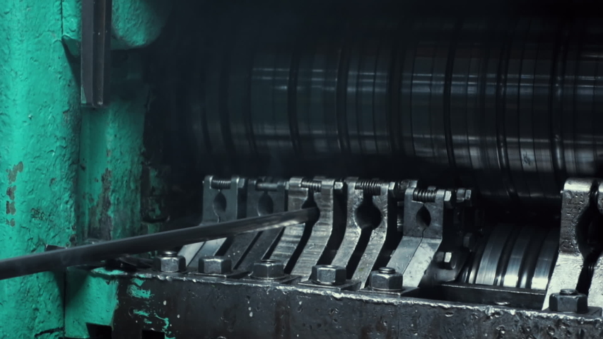 Metal Rolling Machine at Precious Metal Production Factory. Steel Pipes of Silver. Automated industrial line at heavy production plant. Close Up | Shutterstock HD Video #1056167195