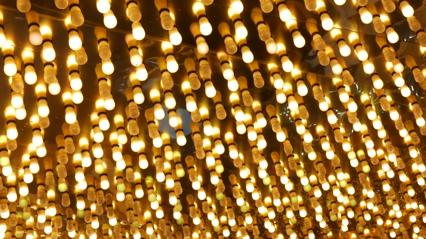 Old fasioned electric lamps blinking and glowing at night. Abstract close up of retro casino decoration shimmering in Las Vegas, USA. Illuminated vintage style bulbs glittering on Freemont street. | Shutterstock HD Video #1056169658