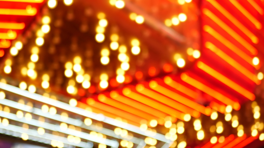 Defocused old fasioned electric lamps glowing at night. Abstract close up of blurred retro casino decoration shimmering, Las Vegas USA. Illuminated vintage style bulbs glittering on Freemont street. | Shutterstock HD Video #1056169691