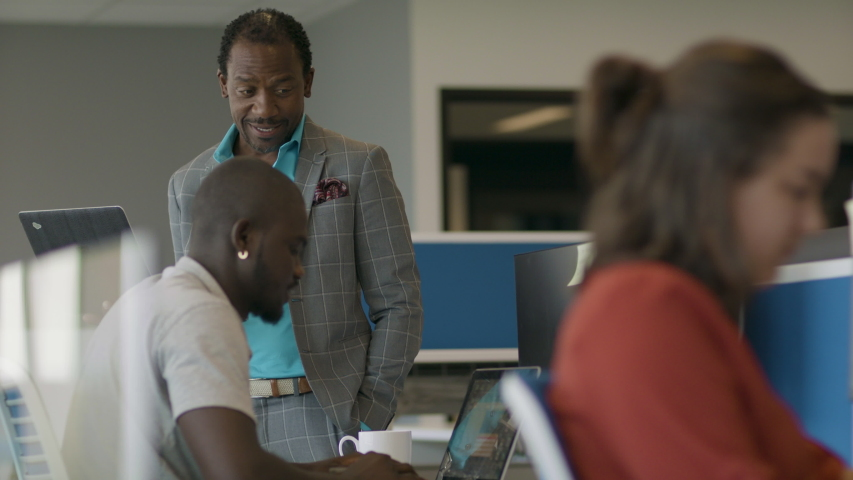 Coworkers collaborating in a modern office. Diversity in the workforce. Tech leaders of the future. Shot in slow-motion and in 4k.  Royalty-Free Stock Footage #1056170924