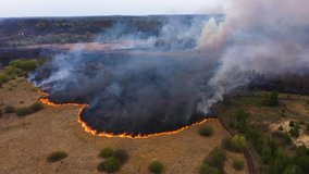 Epic aerial footage of smoking wild fire. Forest and field in the fire. Amazon and siberian wildfires. Dry grass burning. Concept: 2020, Climate change, ecology, earth