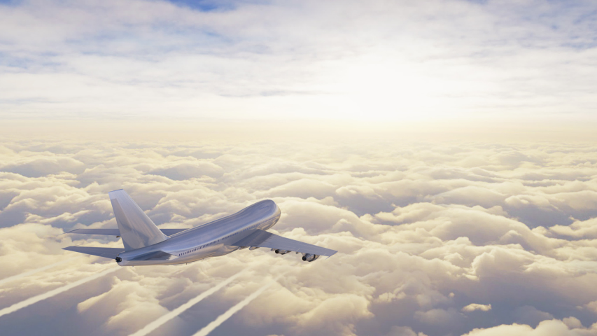 Big jet airplane flying over the sky in beautiful sunrise light. Aerial view of plane above the clouds. Footage in 4K, 16 bit depth